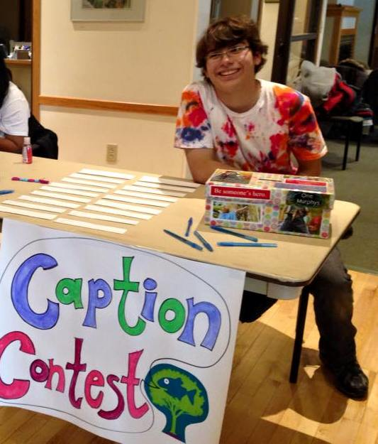 Caption Contest booth with an enthusiastic facilitator :-)
