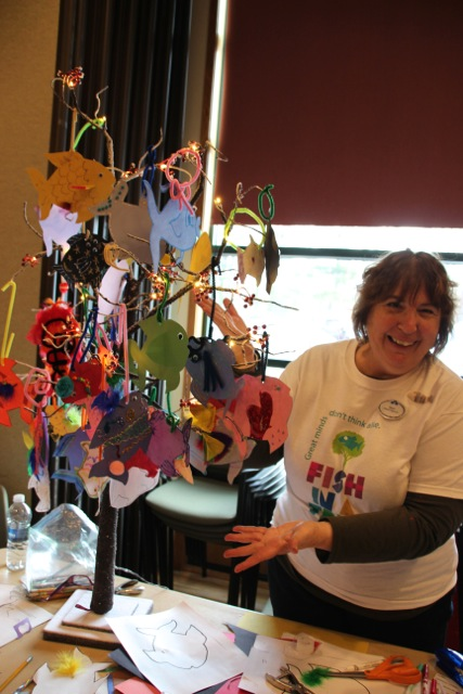West Hartford librarian, Janet Murphy, is the master of making fish for the tree!