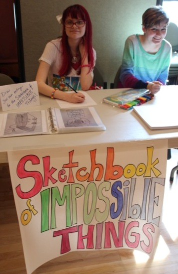 One of the stations where readers could win raffle tickets - Add a Page to The Sketchbook of Impossible Things. GREAT Additions!